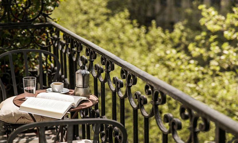 Balcony with a book and freshly brewed coffee in the Champagne vacation rental offered by Paris Perfect