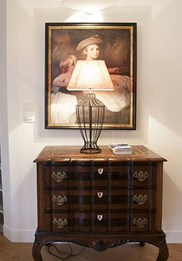 Antique dresser at entrance of the Bordeaux vacation rental offered by Paris Perfect