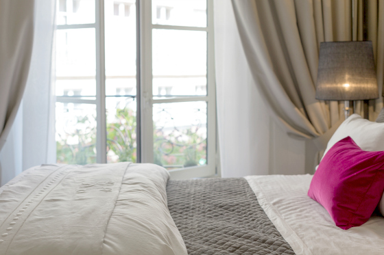 Bedroom with large windows in the Muscat vacation rental offered by Paris Perfect