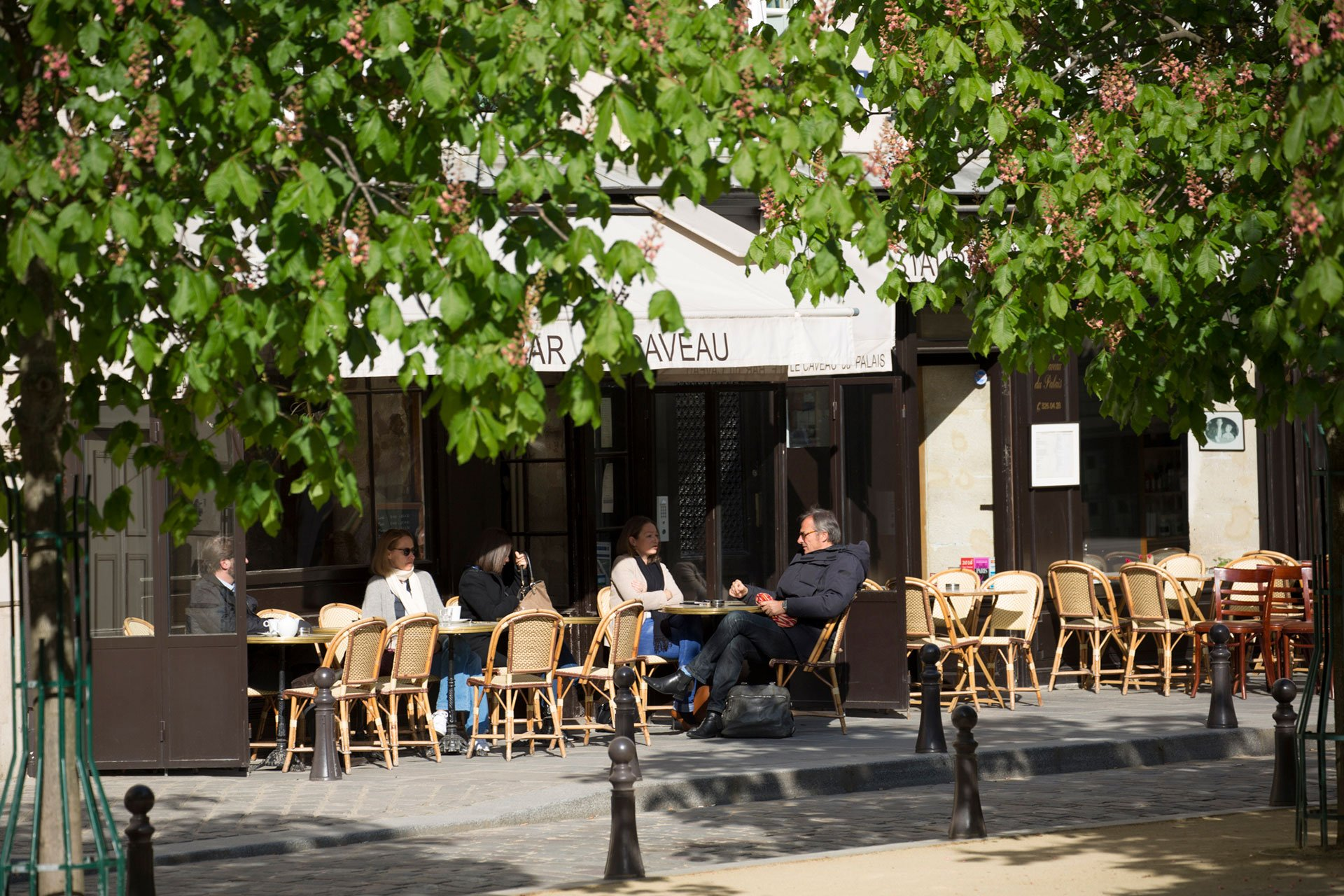 Dine outdoors on Place Dauphine at the excellent Le Caveau