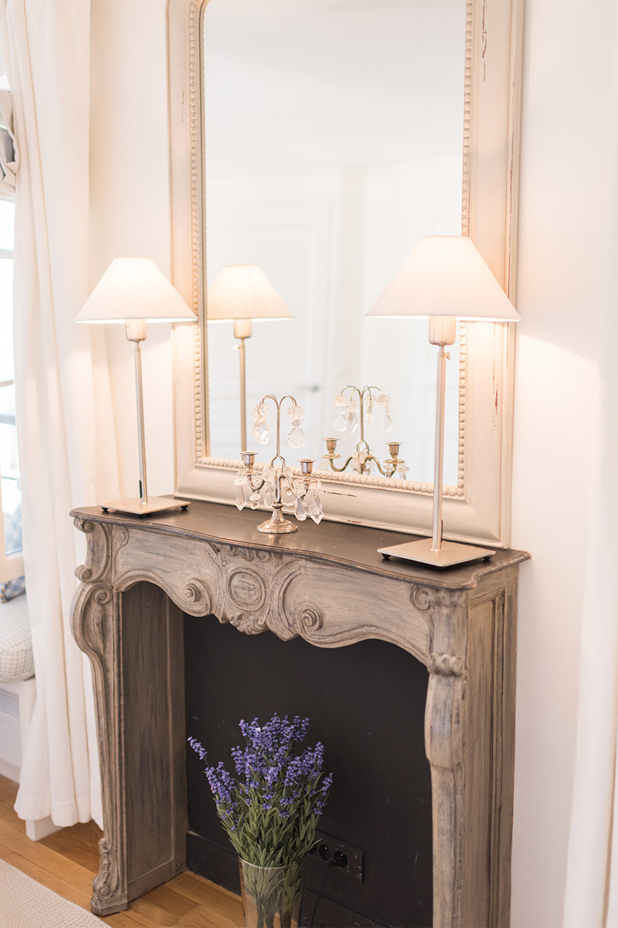 Beautiful decorative fireplace in the Pomerol vacation rental offered by Paris Perfect