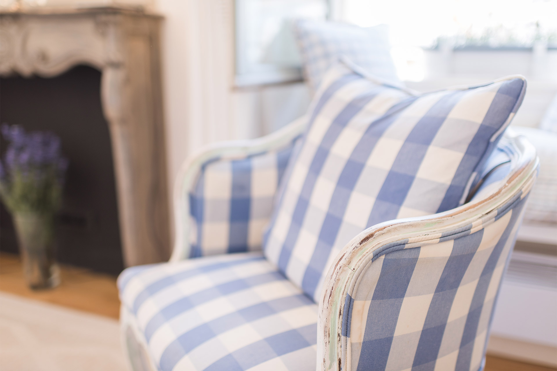 Elegant arm chairs in the living room of the Pomerol vacation rental offered by Paris Perfect