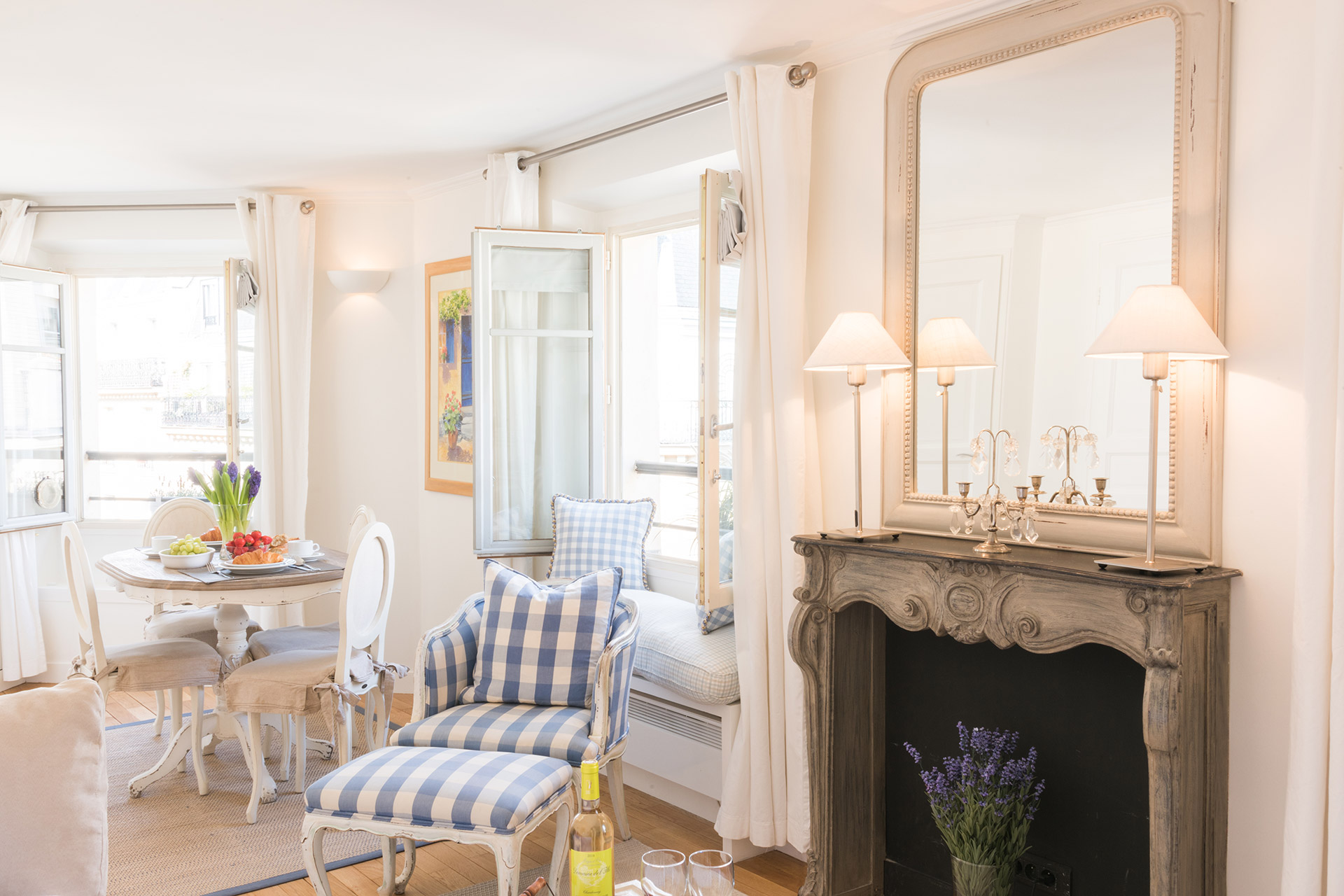Open plan living room maximizes the space in the Pomerol vacation rental offered by Paris Perfect