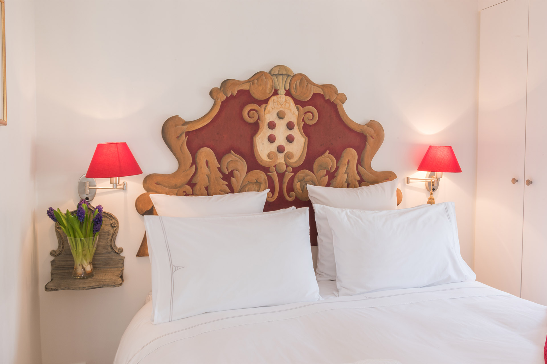 Charming headboard in the bedroom of the Pomerol vacation rental offered by Paris Perfect