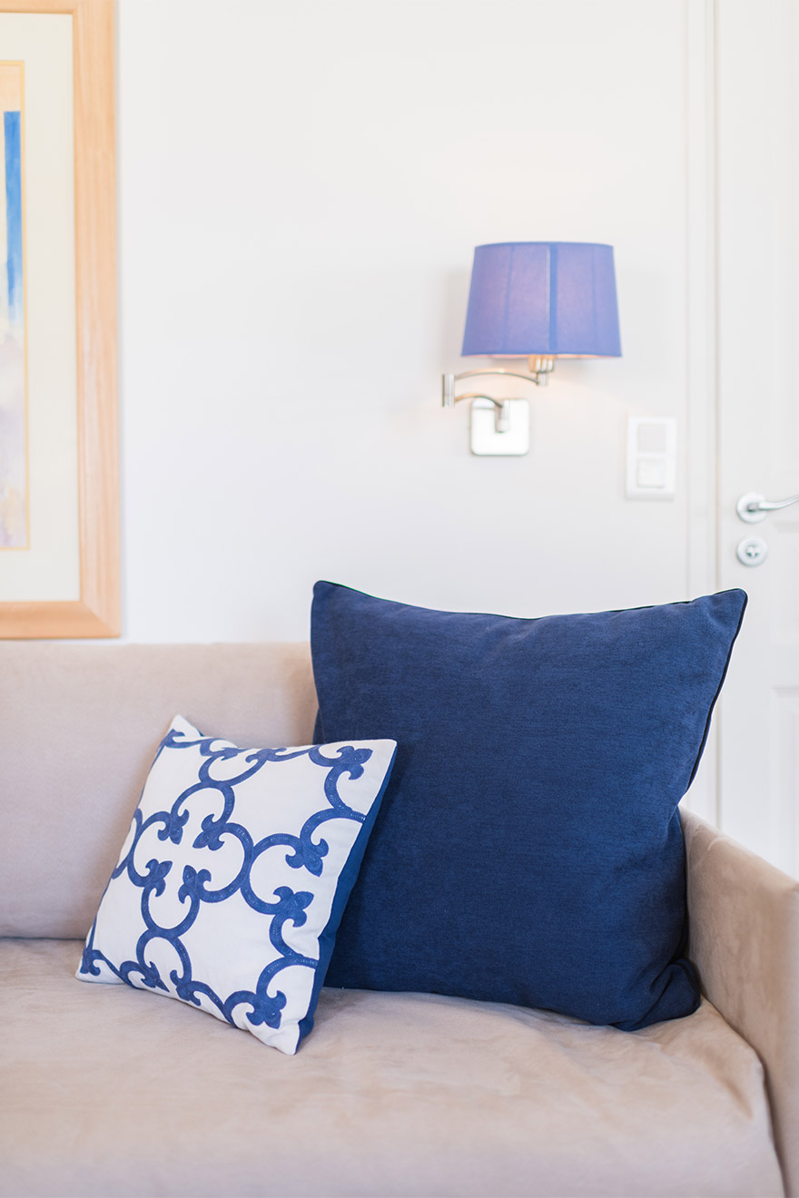 Calm blue touches throughout the living area of the Pomerol vacation rental offered by Paris Perfect