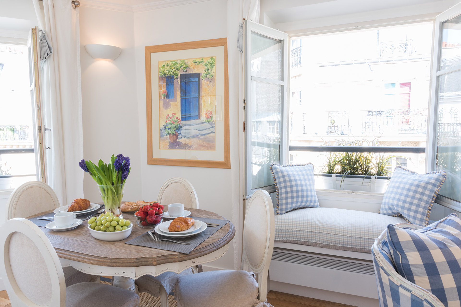 Dining area with romantic window seating in the Pomerol vacation rental offered by Paris Perfect