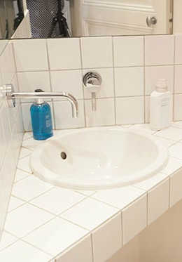 Powder room sink set into an angle in the Chateauneuf vacation rental offered by Paris Perfect