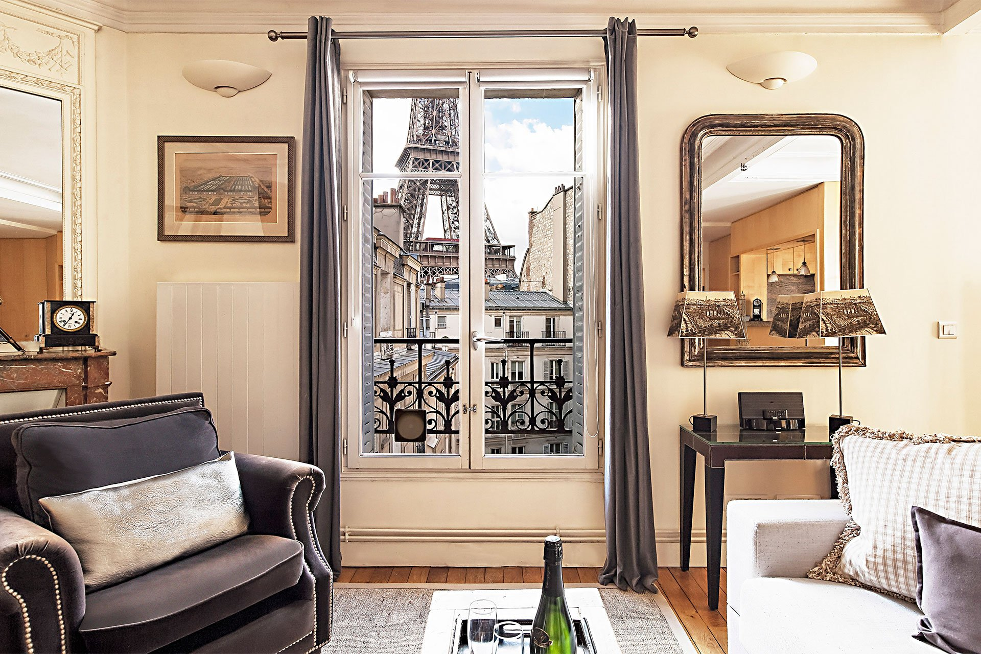Stunning close-up Eiffel Tower view from the living room of the Romanée vacation rental offered by Paris Perfect