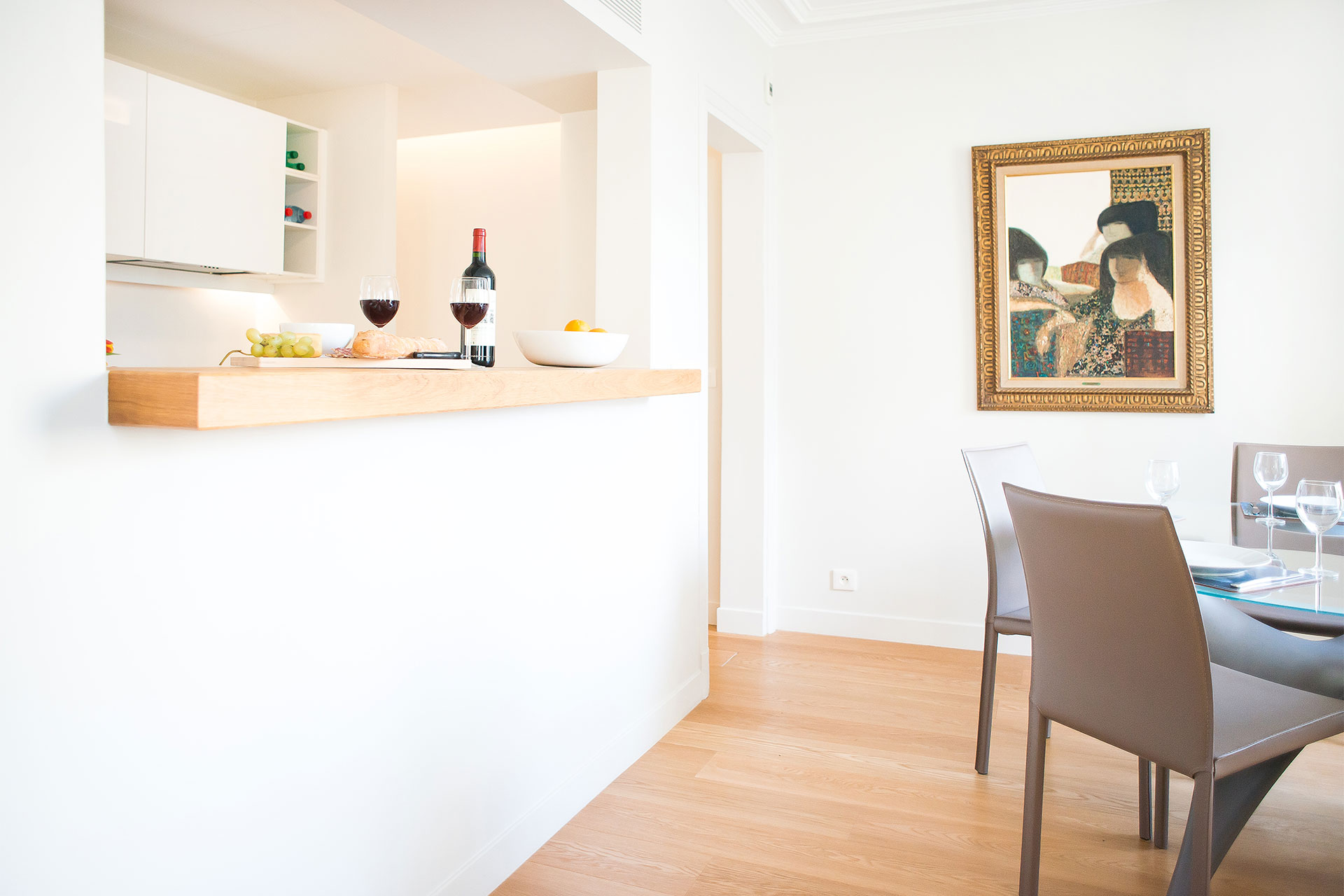 Pass-through window in the kitchen allows for easy entertaining in the Saint-Bris Paris Perfect rental