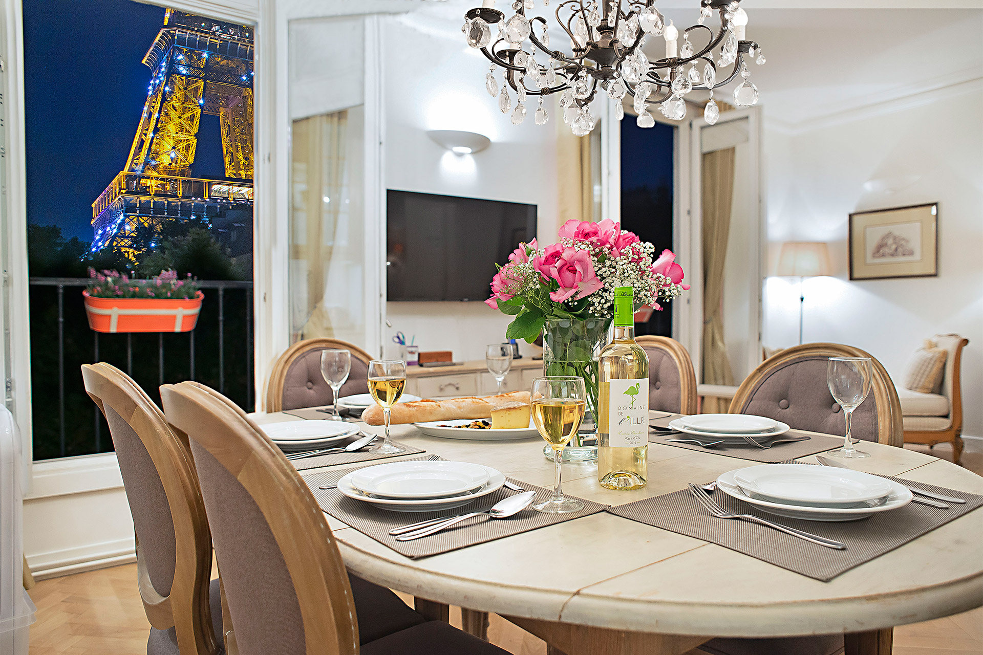 Dinning table with breathtaking Eiffel Tower views in the Saint Emilion vacation rental offered by Paris Perfect