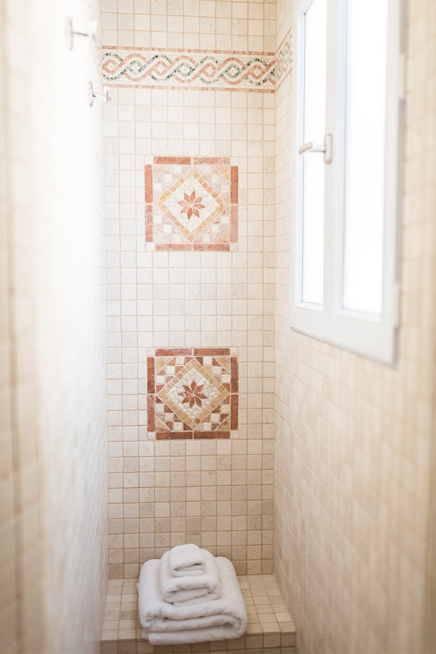 Elegant tile work in the shower in the Saint Emilion vacation rental offered by Paris Perfect