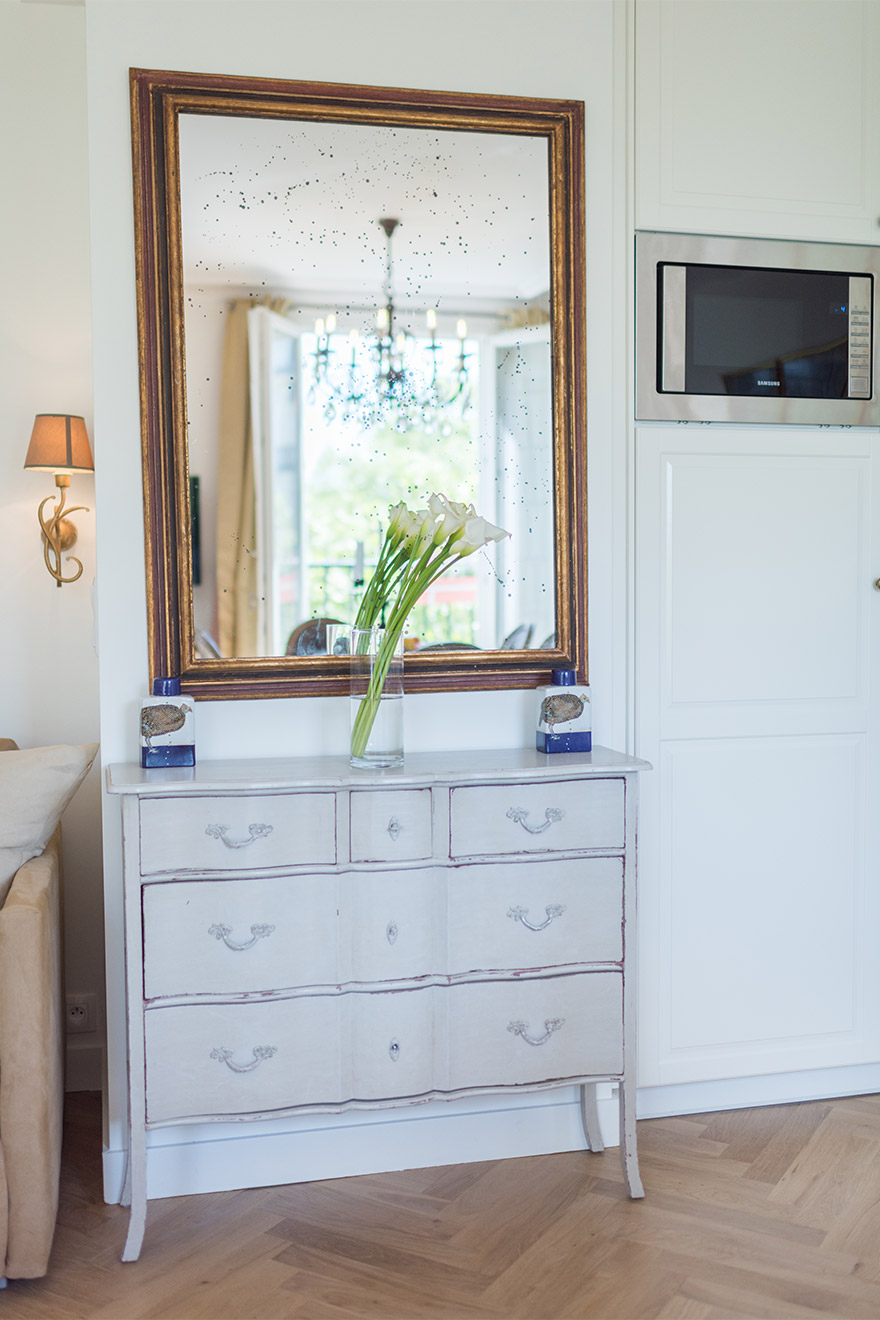 Elegant drawers and mirror in the living area of the Saint Emilion vacation rental offered by Paris Perfect