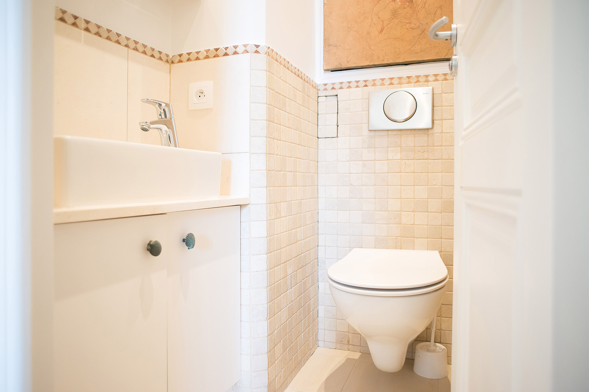 Separate half bath with toilet and sink in the Saint Emilion vacation rental offered by Paris Perfect