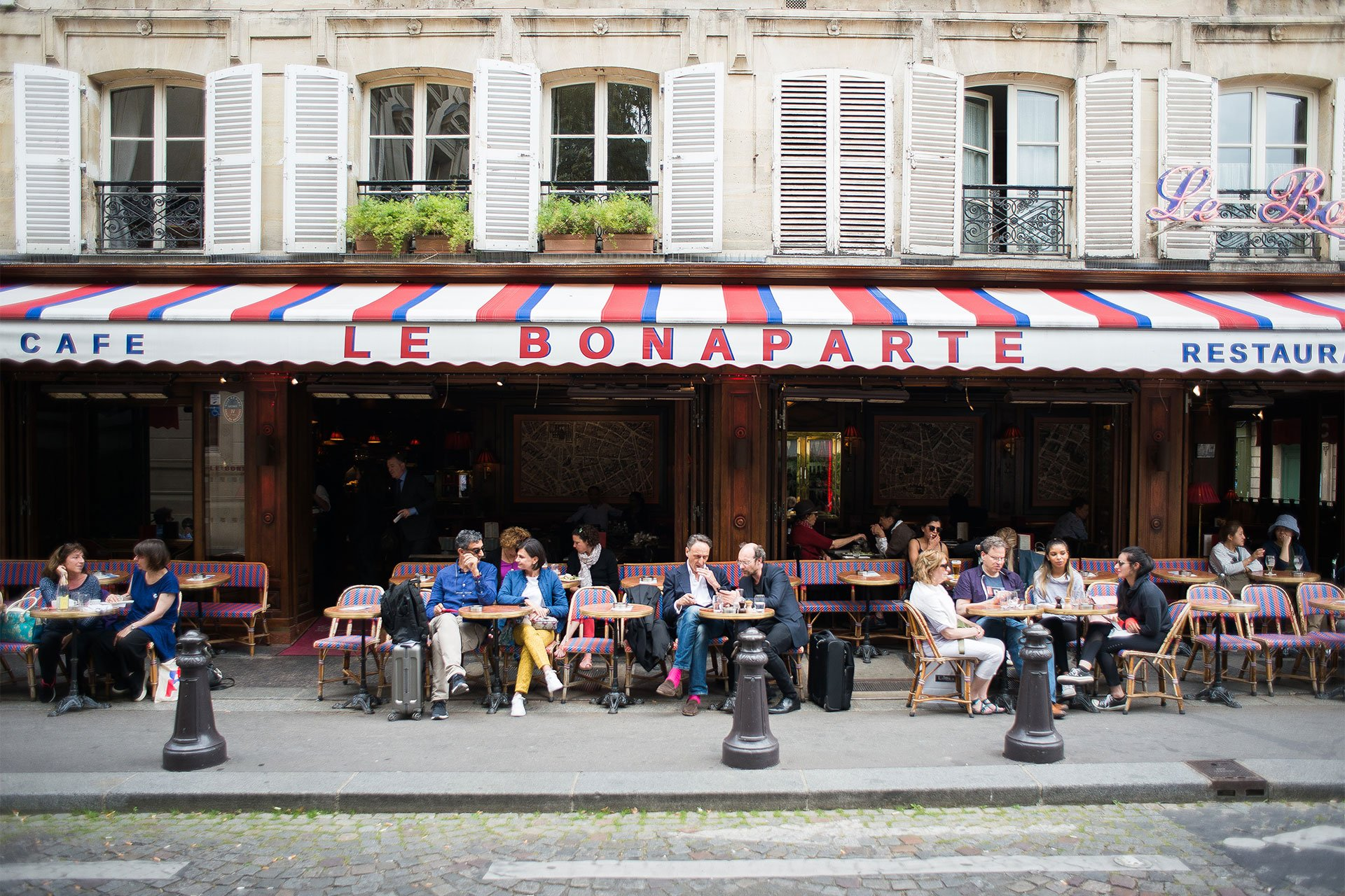Spend a lazy afternoon people watching at a local café - Paris Pefect