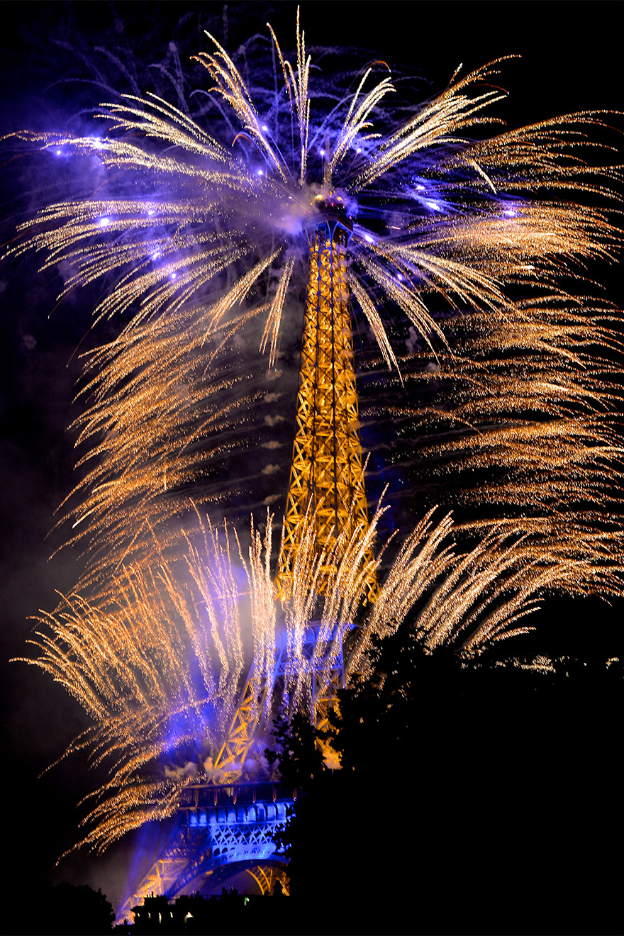 Stunning view from the balcony on Bastille Day in the Merlot vacation rental offered by Paris Perfect