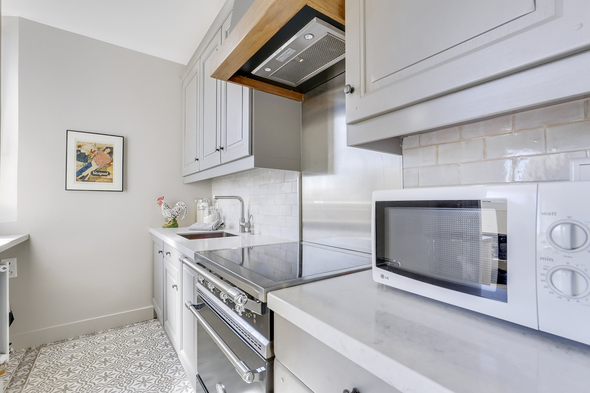 Cook your own meals in this fully-equipped kitchen in the Vivarais vacation rental by Paris Perfect