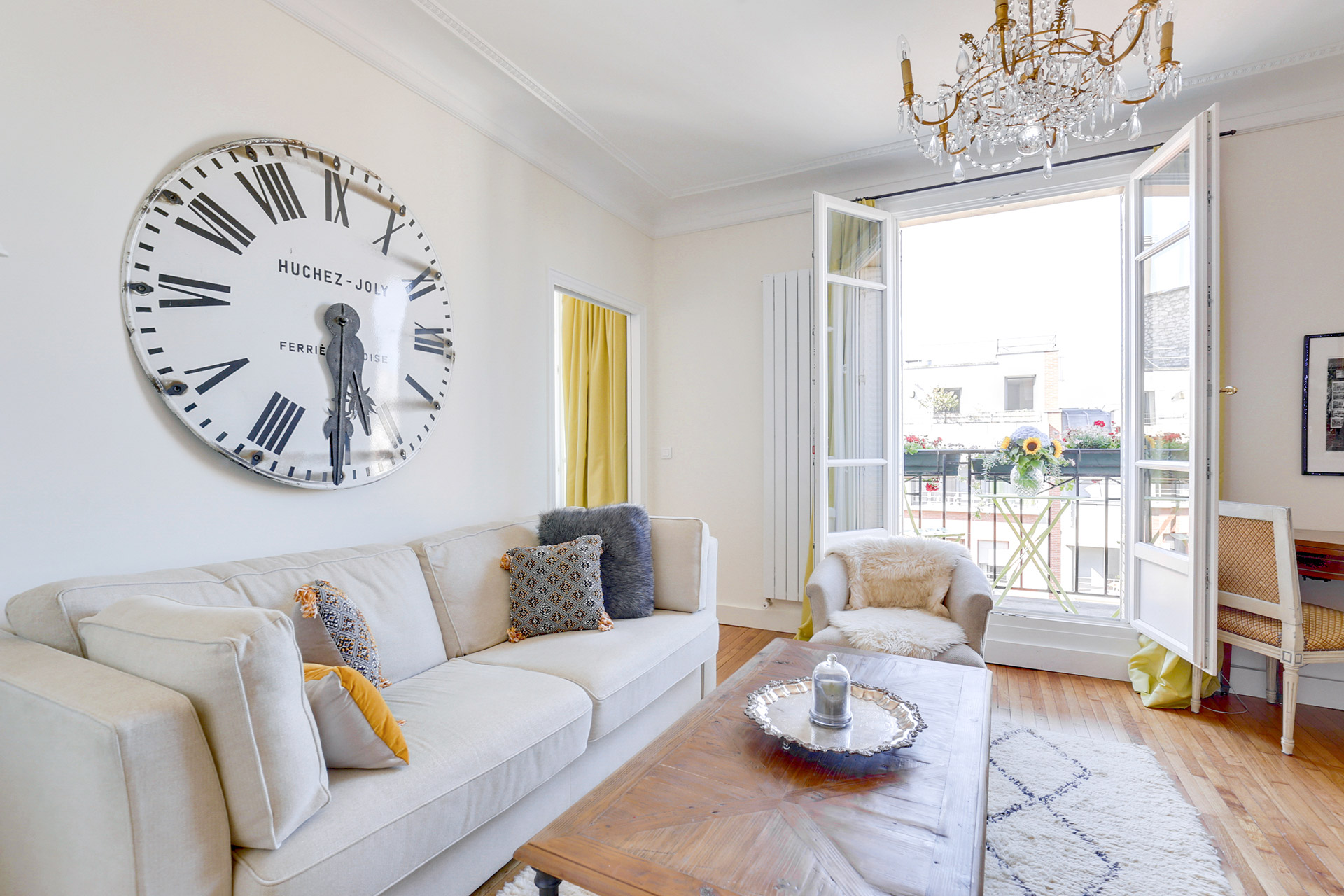 Wonderful, well-lit open living room in the Vivarais apartment rental by Paris Perfect
