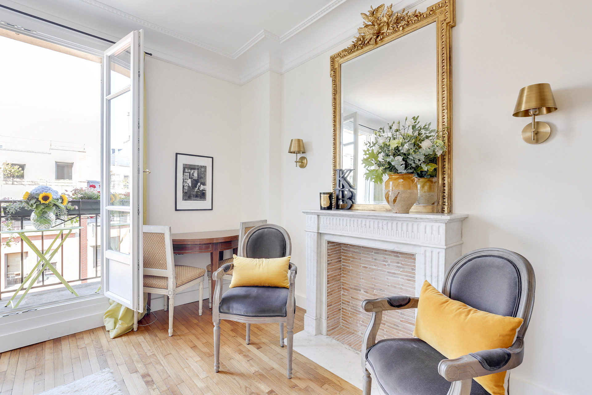Enjoy time with family and friends in front of this beautiful fireplace in the Vivarais apartment rental by Paris Perfect