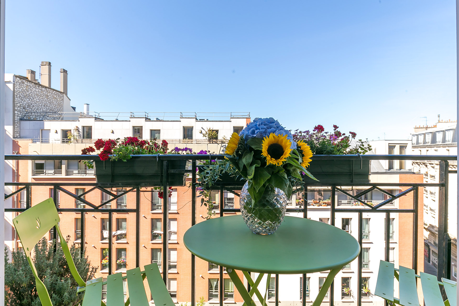 Enjoy a lovely café and breakfast on this balcony in the Vivarais apartment rental by Paris Perfect