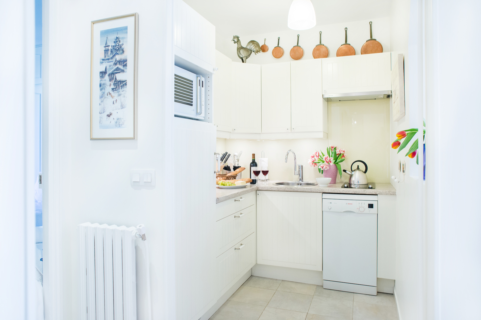 Cozy country-style kitchen of the Vougeot vacation rental offered by Paris Perfect