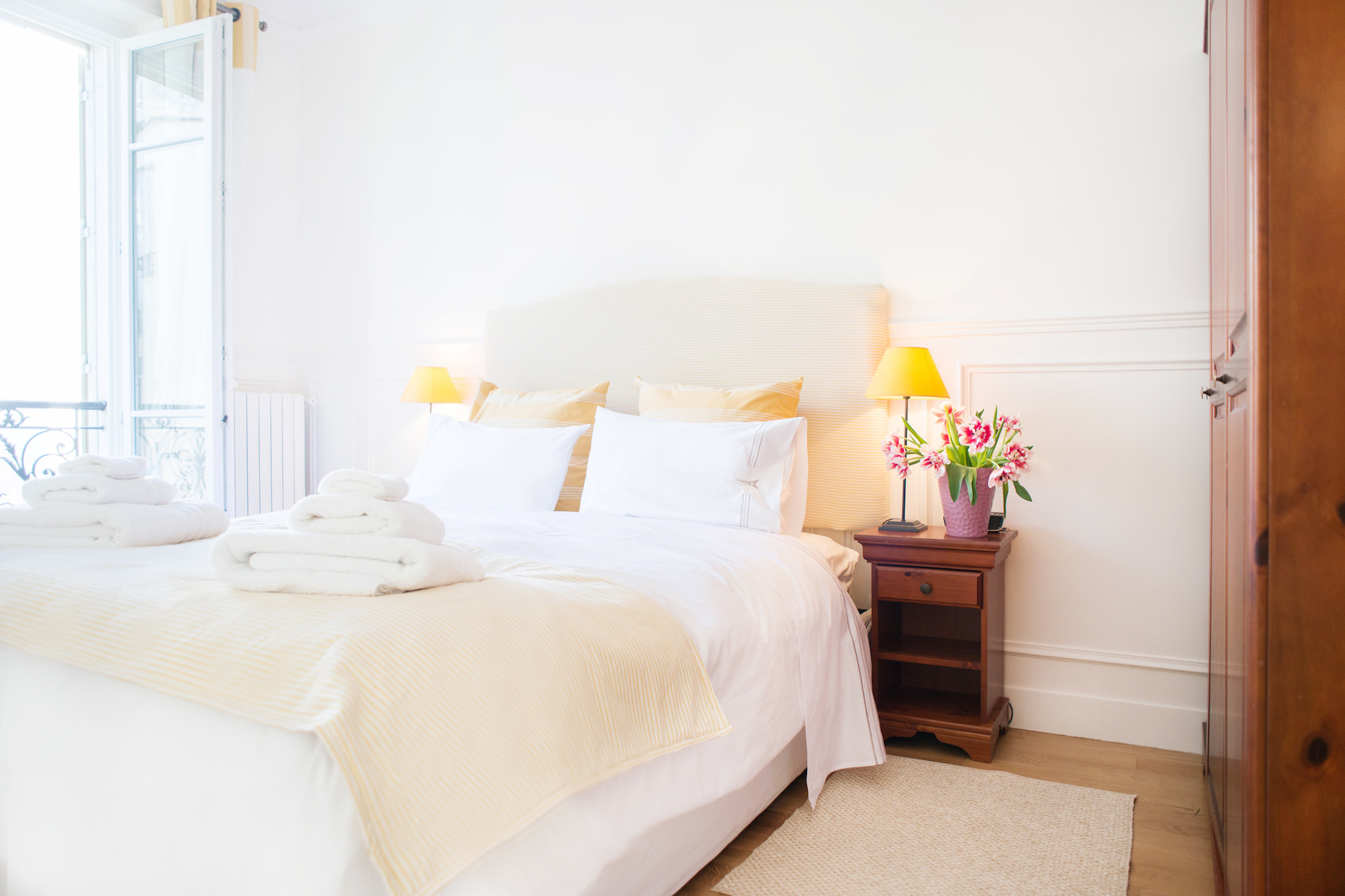 Large window in the first bedroom of the Vougeot vacation rental offered by Paris Perfect