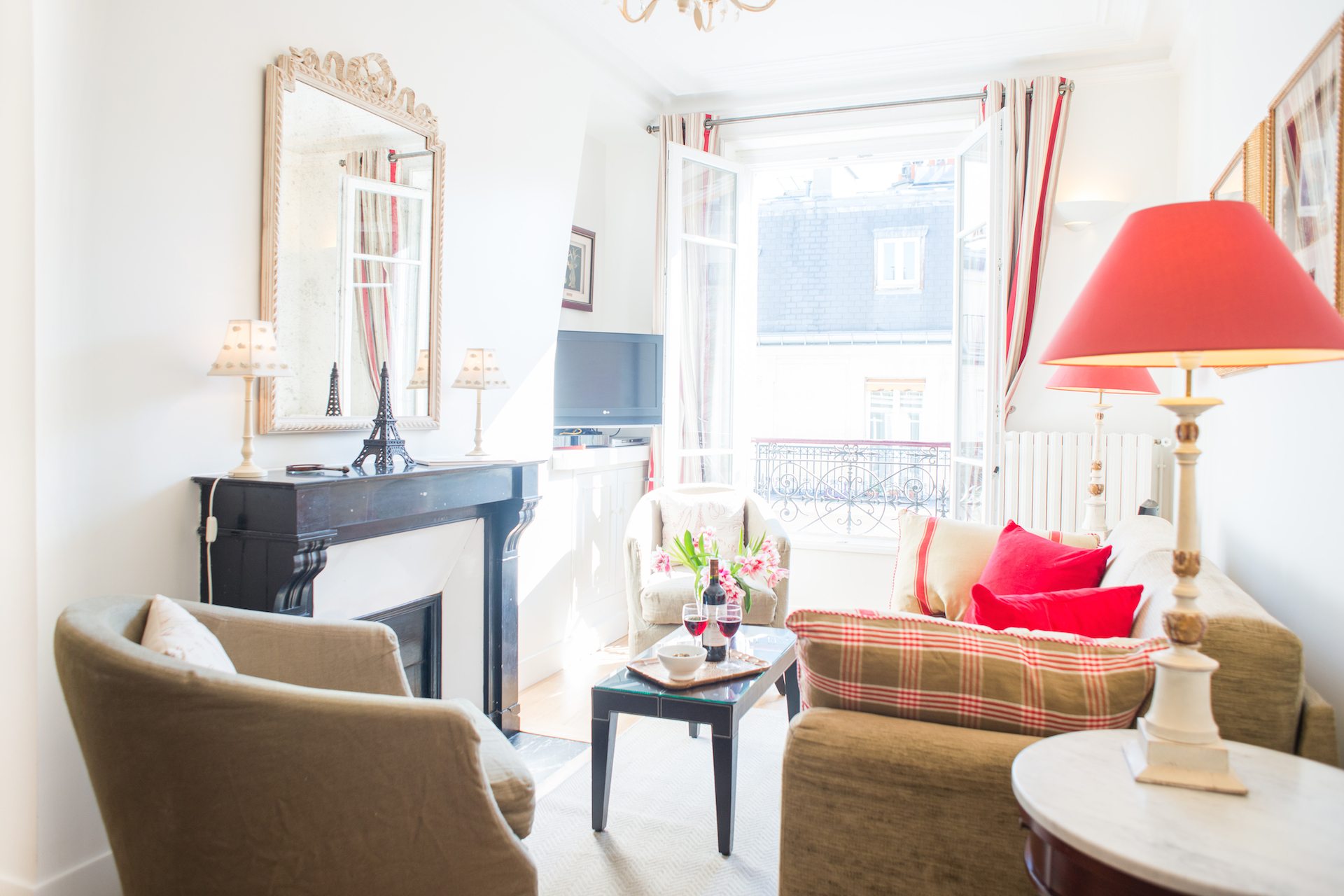 Large French windows provide sunlight in the Vougeot vacation rental offered by Paris Perfect